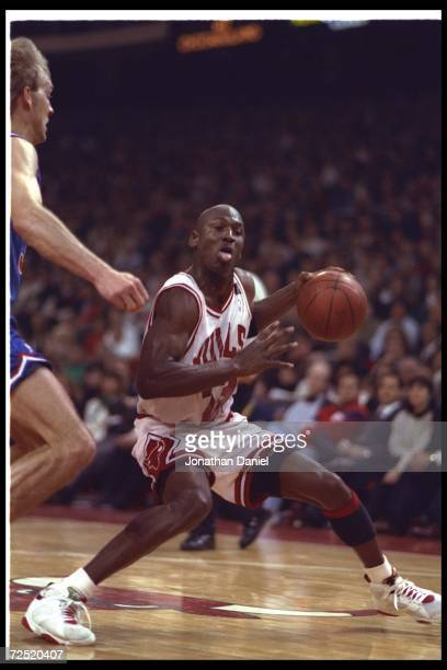 Guard Michael Jordan of the Chicago Bulls moves the ball during a game against the Cleveland Cavaliers at the United Center in Chicago, Illinois.