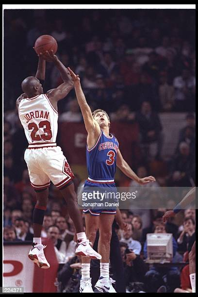 Guard Michael Jordan of the Chicago Bulls takes a shot during a game against the Cleveland Cavaliers at the United Center in Chicago Illinois...