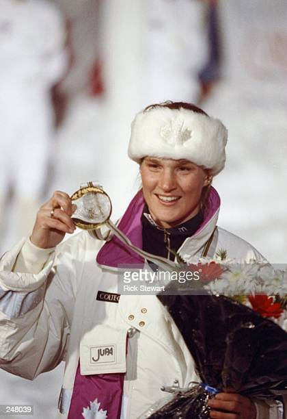 Kerrin LeeGarnter of Canada shows off her medal during the Olympic Games in Albertville France Mandatory Credit Rick Stewart /Allsport