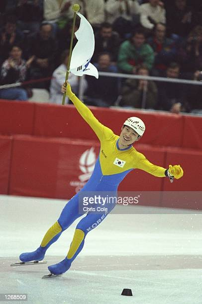 Ki-Hoon Kim of Korea celebrates after winning the gold medal in the 1000 metres Short Track Speed Skating event at the 1992 Winter Olympics in...