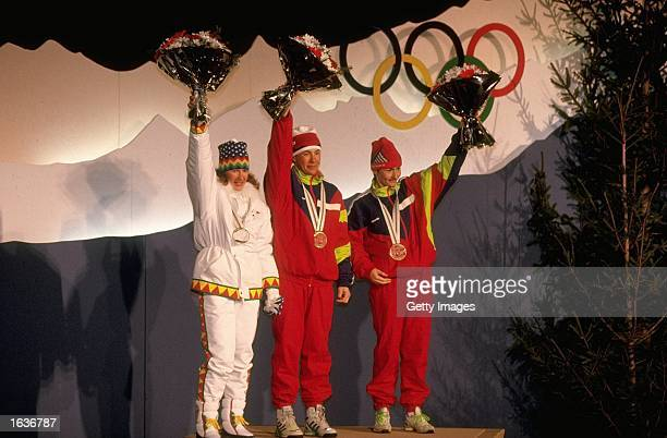 Marjut Lukkarinen of Finland, Lyubov Egoroya and Yelena Valbe both of the Unified Team stand on the winners podium during the medal ceremony for the...