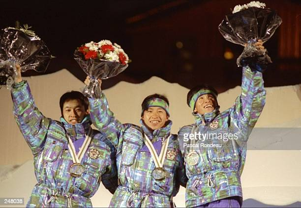 Members of Japan's nordic combined team wave to the crowd after winning gold during the Olympic Games in Albertville, France. Reiici Mikata, Kenji...