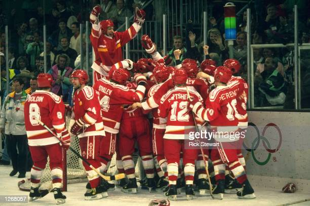 The Unified Team celebrate after winning the gold medal in the Ice Hockey match against Canada at the 1992 Winter Olympic Games in Albertville,...