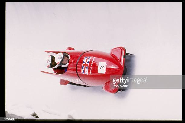Tout and Paul of Great Britain race down the track during the two man bobsleigh competition during the Olympic Games in Albertville, France....