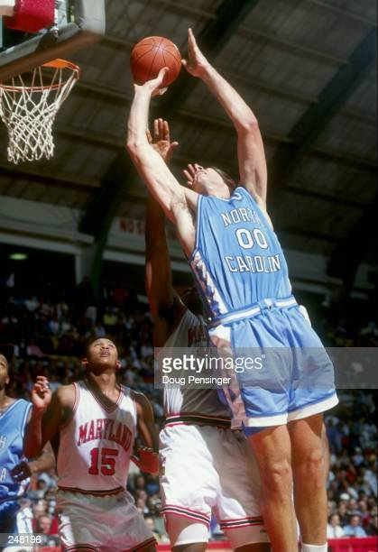 Center Eric Montross of the North Carolina Tar Heels shoots the ball during a game against the Maryland Terrapins at the Cole Field House in College...