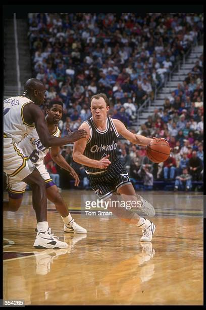 Guard Scott Skiles of the Orlando Magic moves the ball during a game against the Utah Jazz at the Delta Center in Salt Lake City, Utah. Mandatory...