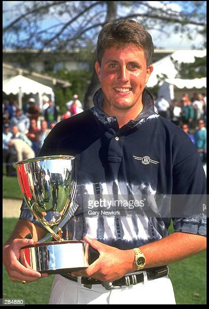 Phil Mickelson holds his trophy from the Buick Invitational of California at Torrey Pines Golf Club in San Diego, California. Mandatory Credit: Gary...