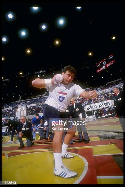 Randy Barnes prepares to throw the shotput during the Sunkist Track and Field competition at the Los Angeles Sports Arena in Los Angeles, California.
