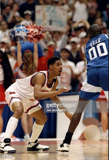 Guard Lawrence Moten of the Syracuse Orangemen covers a Kentucky Wildcats player during a game. Syracuse won the game, 93-85.
