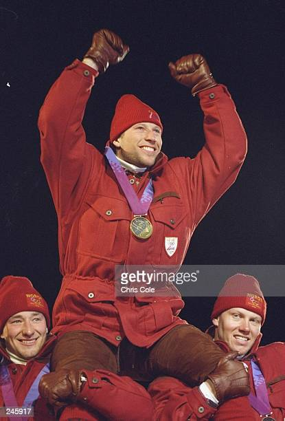 Left Silver medallist Kjetil-Andre Aamodt of Norway and right Bronze Medalist Harald-Christian Strand Nilsen of Norway lift Gold medallist and...