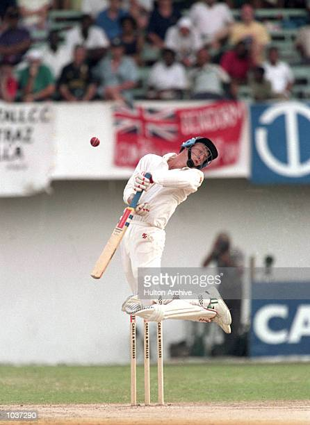 Mike Atherton of England dodges a bouncer during the First Test match against the West Indies at Sabina Park in Kingston, Jamaica. \ Mandatory...