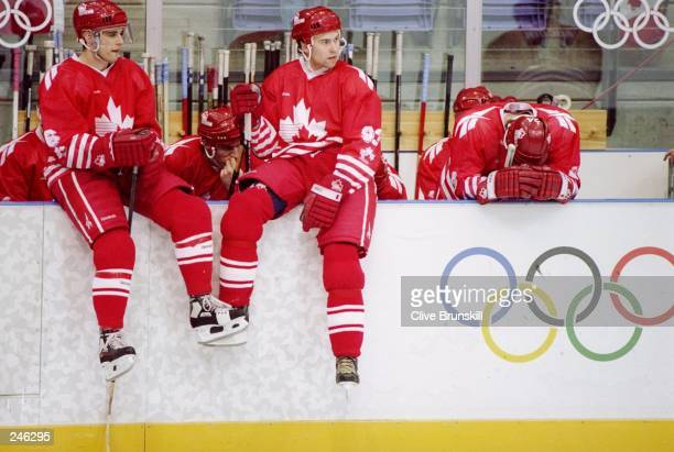 Peter Nedved and Ken Lovsin of Canada sit on the bench during a game at the Olympic Games in Lillehammer Norway Mandatory Credit Clive Brunskill...