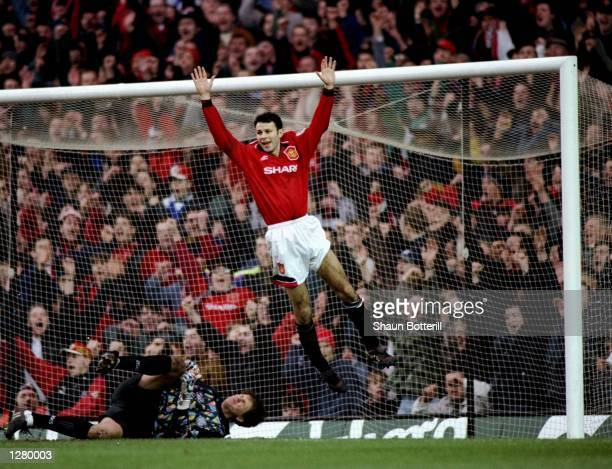 Ryan Giggs of Manchester United celebrates during the FA Cup fifth round match against Leeds United at Old Trafford in Manchester England Manchester...