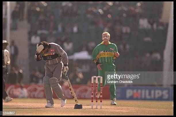 Allan Donald of South Africa hits Sultan Zarawani of the United Arab Emirates on the head with the cricket ball during the cricket world cup in...