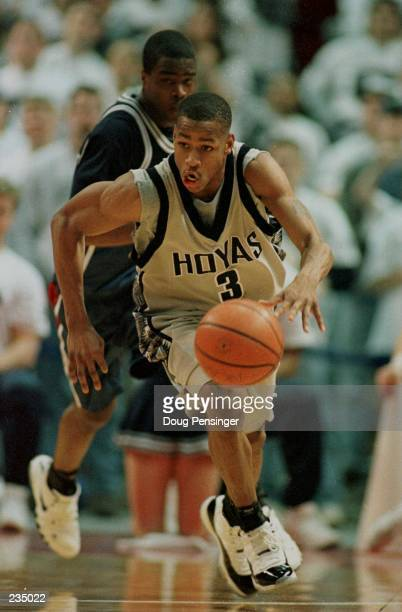 Allen Iverson moves the ball upcourt as his 35 points lead the Georgetown Hoyas to a 10668 defeat of the Villanova Wildcats in their Big East finale...