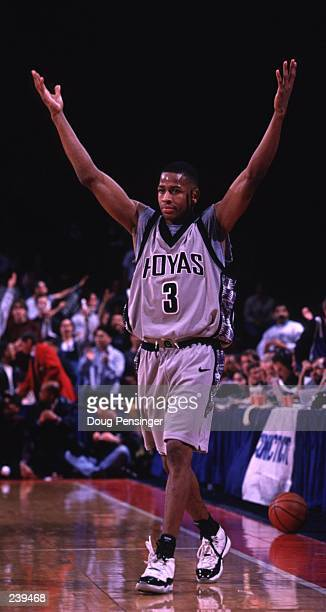 Allen Iverson of Georgetown celebrates as he walks off the court after the Georgetown Hoyas defeat the Connecticut Huskies 7765 at the US Air Arena...