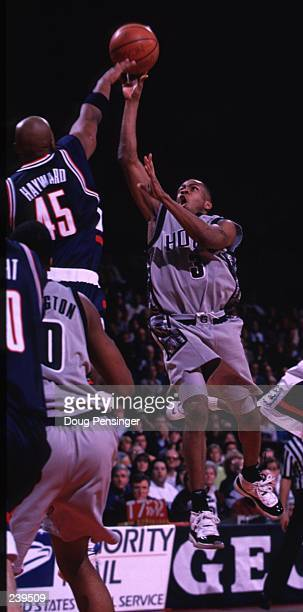 Allen Iverson of Georgetown lofts a shot over Eric Hayward of UConn as the Georgetown Hoyas defeat the Connecticut Huskies by 7765 at the US Air...