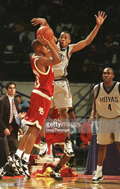 Allen Iverson of the University of Georgetown pressures Duane Woodward of Boston College during the Hoyas 6764 Big East win over Boston College at...