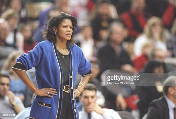 Coach Bernadette LockeMattox of the Kentucky Wildcats watches her players during a game against the Georgia Bulldogs at the Stegeman Coliseum in...