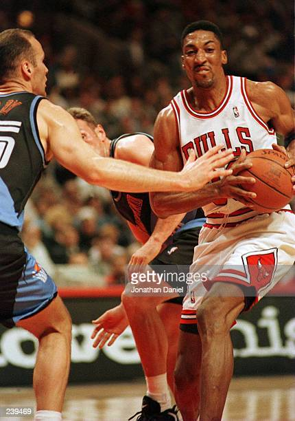 Forward Scottie Pippen of the Chicago Bulls shields the ball from the reaching arm of forward Danny Ferry of the Cleveland Cavaliers during first...