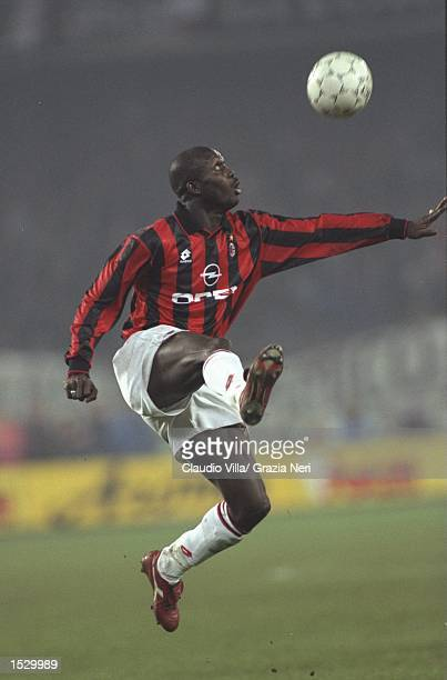 George Weah of AC Milan in action during the Serie A match against Juventus at the San Siro Stadium in Milan Italy Mandatory Credit Claudio...