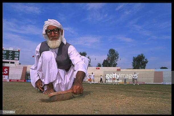 Groundstaff weed the pitch at Rawalpindi cricket ground, during the match between England and the United Arab Emirates during the cricket world cup...