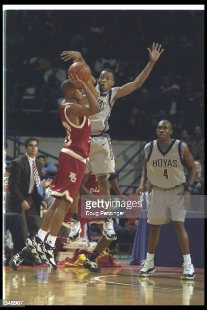 Guard Duane Woodward of the Boston College Eagles shoots the ball as Georgetown Hoyas guard Allen Iverson covers him during a game at the USAir Arena...