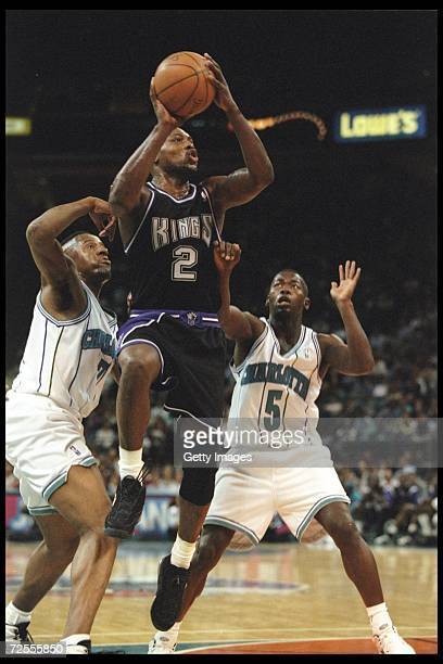 Guard Mitch Richmond of the Sacramento Kings works against guard Anthony Goldwire of the Charlotte Hornets during a game played at the Charlotte...