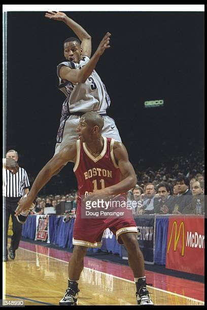 James Penn of the Boston College Eagles looks for the ball as Georgetown Hoyas guard Allen Iverson goes airborne to cover him during a game at the...
