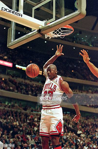 Michael Jordan of the Chicago Bulls dunks the ball during the game against the Minnesota Timberwolves at the United Center in Chicago Illinois The...