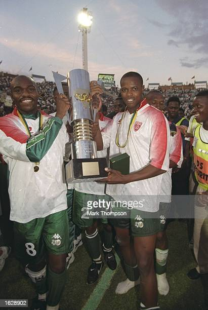 Phil Masinga and Buthelezi with the trophy after victory in the African Nations Cup Final against Tunisia in South Africa South Africa won the match...