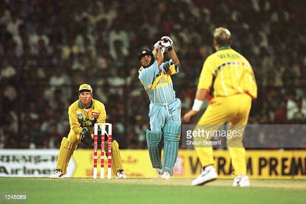 Sachin Tendulkar of India plays a shot off the bowling of Shane Warne of Australia during the Cricket World Cup match between Australia and India in...