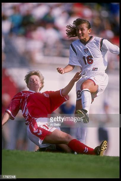 Tiffeny Milbrett of the USA and Annette Laursen of Denmark fight for the ball during a game in Orlando Florida The USA won the game 21 Mandatory...