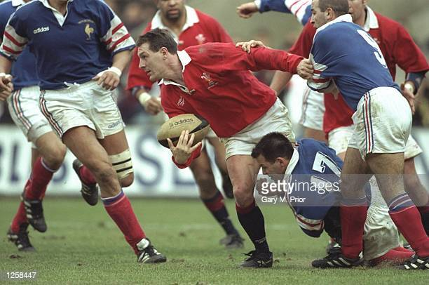 Allan Bateman of Wales desperately looks for support during the Five Nations international between France And Wales at the Parc Des Princes in Paris...