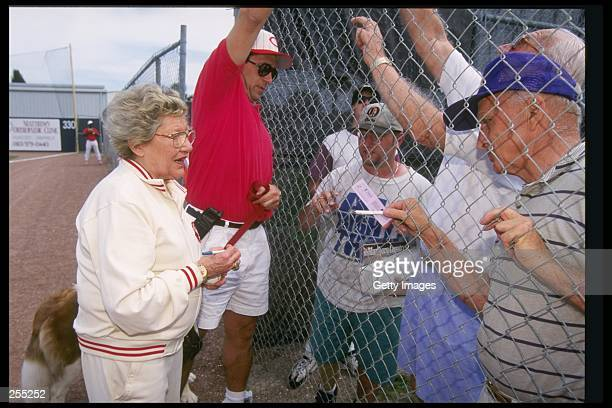Cincinnati Reds owner Marge Schott signing autographs during a spring training game against the Texas Rangers in Plant City Florida Mandatory Credit...
