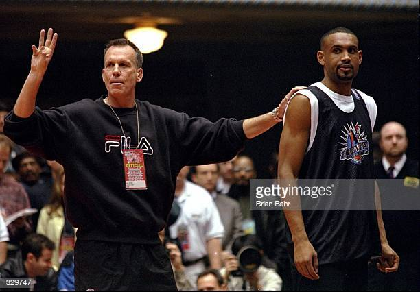 Coach Doug Collins and forward Grant Hill of the Detroit Pistons stand together during a practice session for the East team prior to the NBA AllStar...
