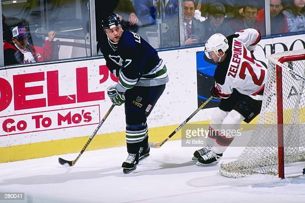 75639cf25 Defenseman Curtis Leschyshyn of the Hartford Whalers moves down the ice  during a game against the