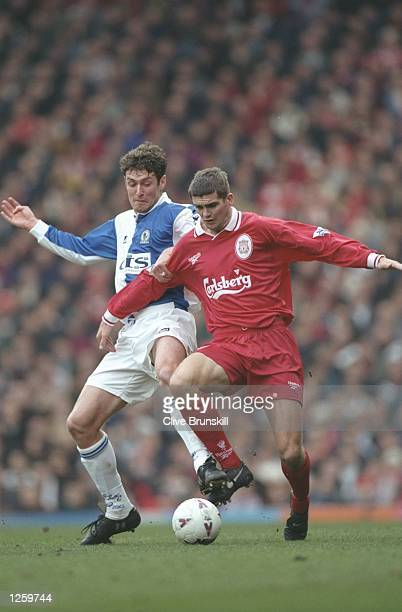 Dominic Matteo of Liverpool challenged by Chris Sutton during the FA Carling Premiership game at Anfield The game ended 0 0 Mandatory Credit Clive...