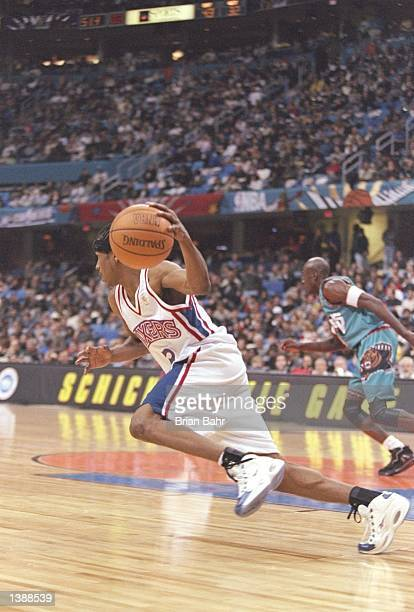 Guard Allen Iverson of the Philadelphia 76ers dribbles the ball down the court during the NBA AllStar Rookie Game at the Gund Arena in Cleveland Ohio...
