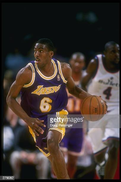 Guard Eddie Jones of the Los Angeles Lakers moves the ball during a game against the Washington Bullets at the USAir Arena in Landover Maryland The...