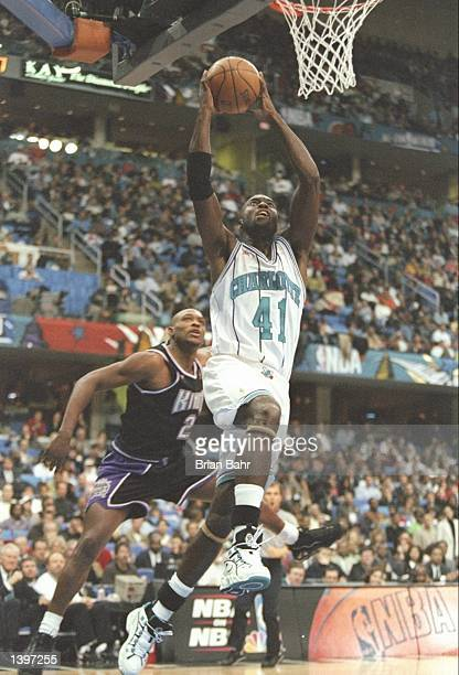 Guard Glen Rice of the Charlotte Hornets drives past guard Mitch Richmond of the Sacramento Kings during the NBA AllStar Game at the Gund Arena in...