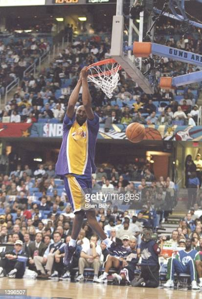 Guard Kobe Bryant of the Los Angeles Lakers slam dunks the ball during the NBA All-Star Slam Dunk Contest at the Gund Arena in Cleveland, Ohio....