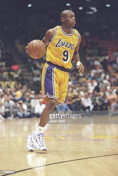 Guard Nick Van Exel of the Los Angeles Lakers dribbles the ball down the court during a game against the Cleveland Cavaliers at the Great Western...
