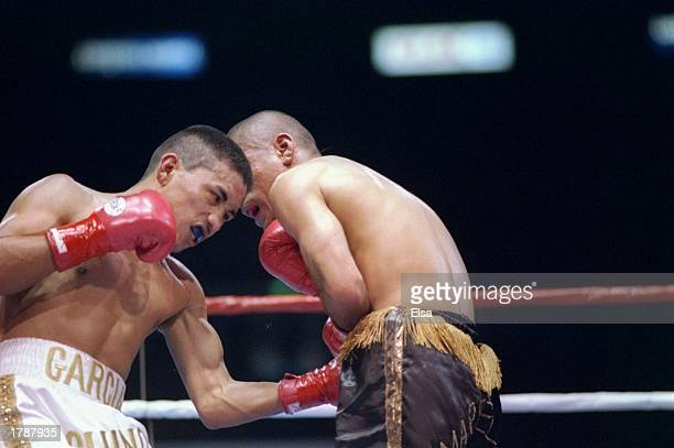 Isidro Garcia lands a punch to the stomach of Carlos Hernandez during their fight at the Great Western Forum in Inglewood California Mandatory Credit...