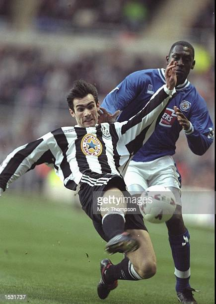 Keith Gillespie of Newcastle lunges for the ball as Emile Heskey of Leicester gives chase During the FA Carling Premier league match between...