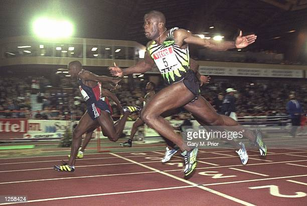 Michael Green of Jamaica beats Bruny Surin of Canada to the line during the Ricoh Indoor Tour Vittel Pas Du Calais Meet in Lievin, France. \...