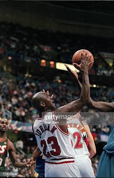 Michael Jordan of the Chicago Bulls jumps to make the basket during the NBA AllStar Game at the Gund Arena in Cleveland OhioThe East defeated the...