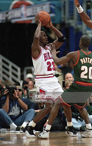 Michael Jordan of the Chicago Bulls looks to pass the ball during the NBA AllStar Game at the Gund Arena in Cleveland OhioThe East defeated the West...