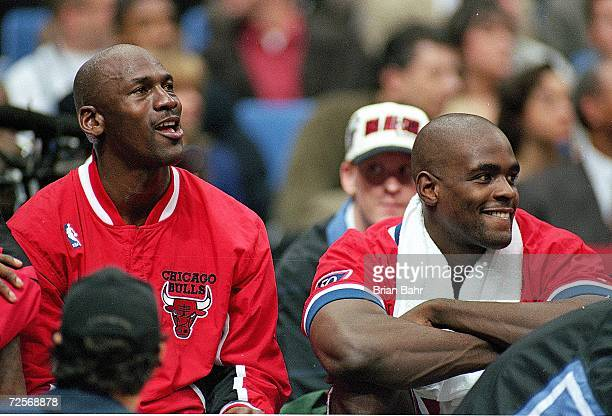 Michael Jordan of the Chicago Bulls sits on the bench with Chris Webber during the NBA AllStar Game at the Gund Arena in Cleveland OhioThe East...