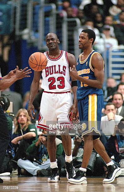 Michael Jordan of the Chicago Bulls stands on the court during the NBA AllStar Game at the Gund Arena in Cleveland OhioThe East defeated the West...